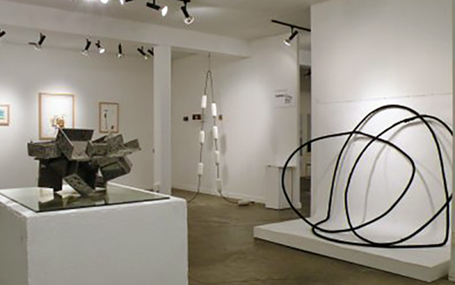 Sitelines group show- (foreground) Fragment- ash over foamcore with mirror. (middle) Shadows-black pigment over rubber hose. (background) Floats- plaster and steel